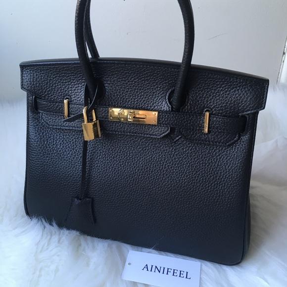 1b8e6ac0d9 AINIFEEL Handbags - AINIFEEL Leather Bag in Black Gold tone hardware.